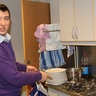 Artem is washing the dishes