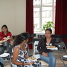 Au pairs Anusha (from Sri-Lanka) and Florean Mae (Philippines) are talking while having a lunch